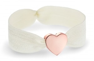 ivory bracelet with rose gold heart